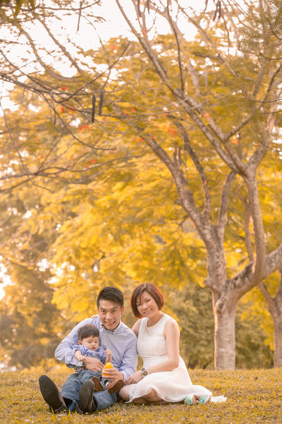 Chinese Family ASIA Asian  Asian Family Autumn Bonding Change Chinese Day Friendship Full Length Happiness Leaf Leisure Activity Lifestyles Nature Outdoors Park - Man Made Space Real People Sitting Smiling Togetherness Tree Two People Young Adult Young Women