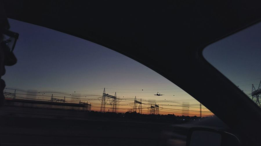 Can you find a flight in this picture? Mobilephotography Dubai Flight Sky On The Road Hanging Out Vehicles Car