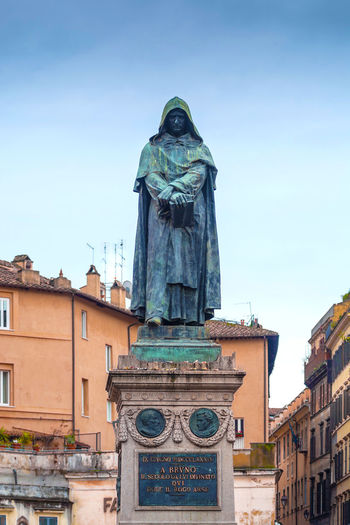 Giordano Bruno was an Italian Dominican friar, philosopher, mathematician, poet, and astrologer.He is celebrated for his cosmological theories, which went even further than the then novel Copernican model Architecture Art Blue Built Structure Campo De' Fiori Capital Cities  City Creativity Day Famous Place Giordano Bruno Heretic Low Angle View No People Outdoors Rome Sculpture Sky Statue Tourism Travel Destinations Moving Around Rome