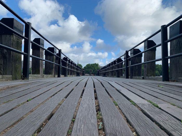 View of boardwalk in city against sky