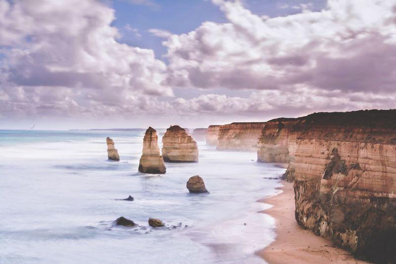 Twelve apostles against cloudy sky