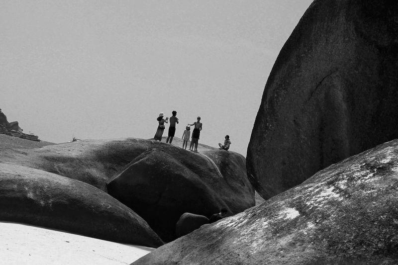 Family On Rocks At Beach