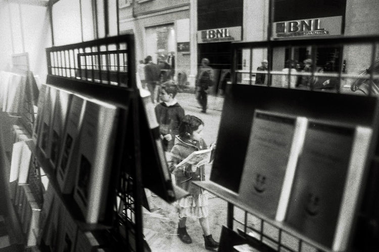 Kids through a window Kids Library The Street Photographer - 2018 EyeEm Awards Bnw Bnw_collection Casual Clothing Day Girl Glass - Material Indoors  Italy Lifestyles People Real People Standing Window