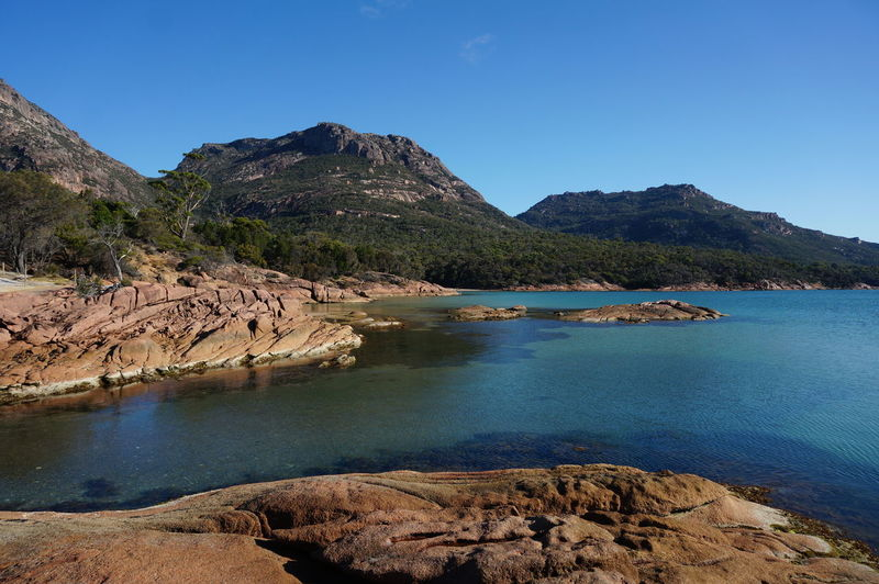 Water Scenics - Nature Mountain Tranquil Scene Tranquility Beauty In Nature Sky Rock Solid Blue Rock - Object Clear Sky No People Nature Non-urban Scene Day Mountain Range Outdoors Rocky Coastline Honeymoon Bay Tasmania Australia Freycinet National Park Sea Landscape Travel Ocean Green Tourism Panorama The Great Outdoors - 2019 EyeEm Awards