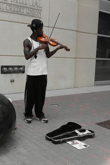 Met this young man as I was strolling around Downtown Fayetteville. He is amazing and can play ANY song Musician Violinist Talented. He Aspire to have his own Orchestra one day! Streetphotography Streetphoto_bw Arts