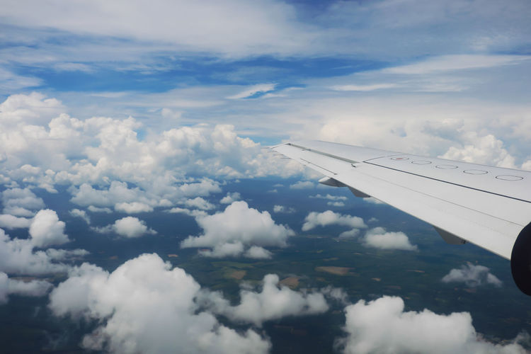 Aerial view of airplane flying over landscape