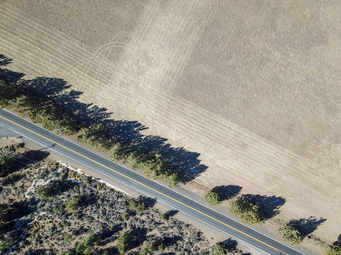 aerial road diagonal line shadows Road Transportation High Angle View Tree Day Landscape Nature Scenics - Nature Plant Beauty In Nature No People Land Environment Outdoors Tranquility Aerial View Mode Of Transportation Motion Tranquil Scene Highway Arid Climate