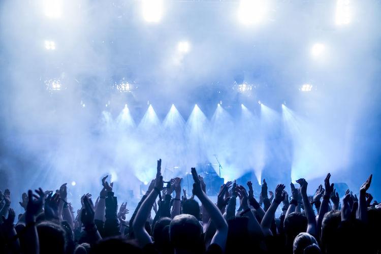 Rear view of crowd enjoying during music concert