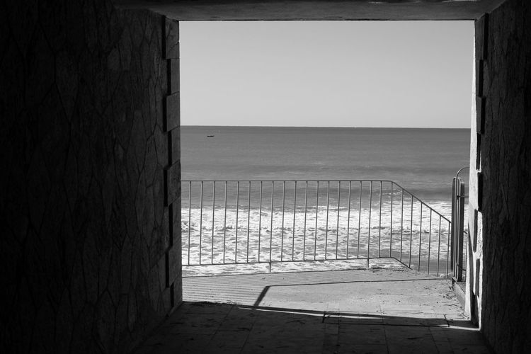 Sea Against Clear Sky Seen Through Tunnel