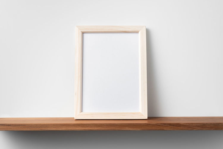 Close-up of table against white background