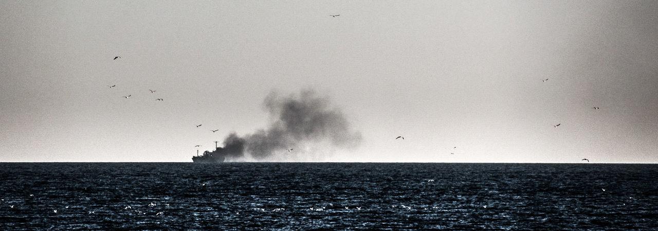 smoke on the water Burning Ship Horizon Over Water Remote Sea Seagulls Sky Smoke Water Waterfront Fine Art Photography