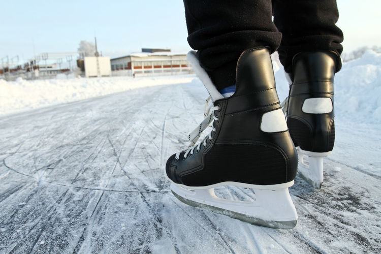 Low section of person ice-skating