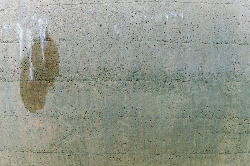 Detail of an Old wall pool with a wet stain Architecture Backgrounds Building Exterior Built Structure Cement Close-up Concrete Concrete Wall Construction Material Day Full Frame Gray No People Outdoors Pattern Rough Surface Level Textured  Wall Wall - Building Feature Weathered