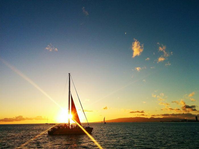 Sunset sailing with friends in Waikiki, Hawaii. Sea Sailing Relaxing Sunset Sailboat Waikiki Hawaii Ocean Cityscape Sunshine