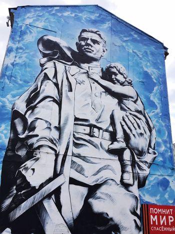 """A saved world remembers"" says a pro-communist mural on a building near the Bolshoy Kamenny Bridge Streetphotography Rus2015tc Traveling ArtWork"