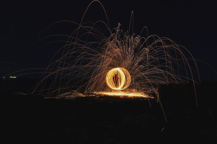 Light painting against clear sky at night