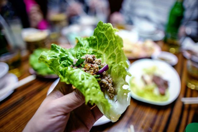 Thai Cuisine Dinner Discoverhongkong Thai Cuisine Human Hand Human Body Part Food And Drink Food One Person Freshness Holding Real People Focus On Foreground Unrecognizable Person Close-up Green Color Unhealthy Eating Indoors  Table Ready-to-eat Plate Lifestyles People Day