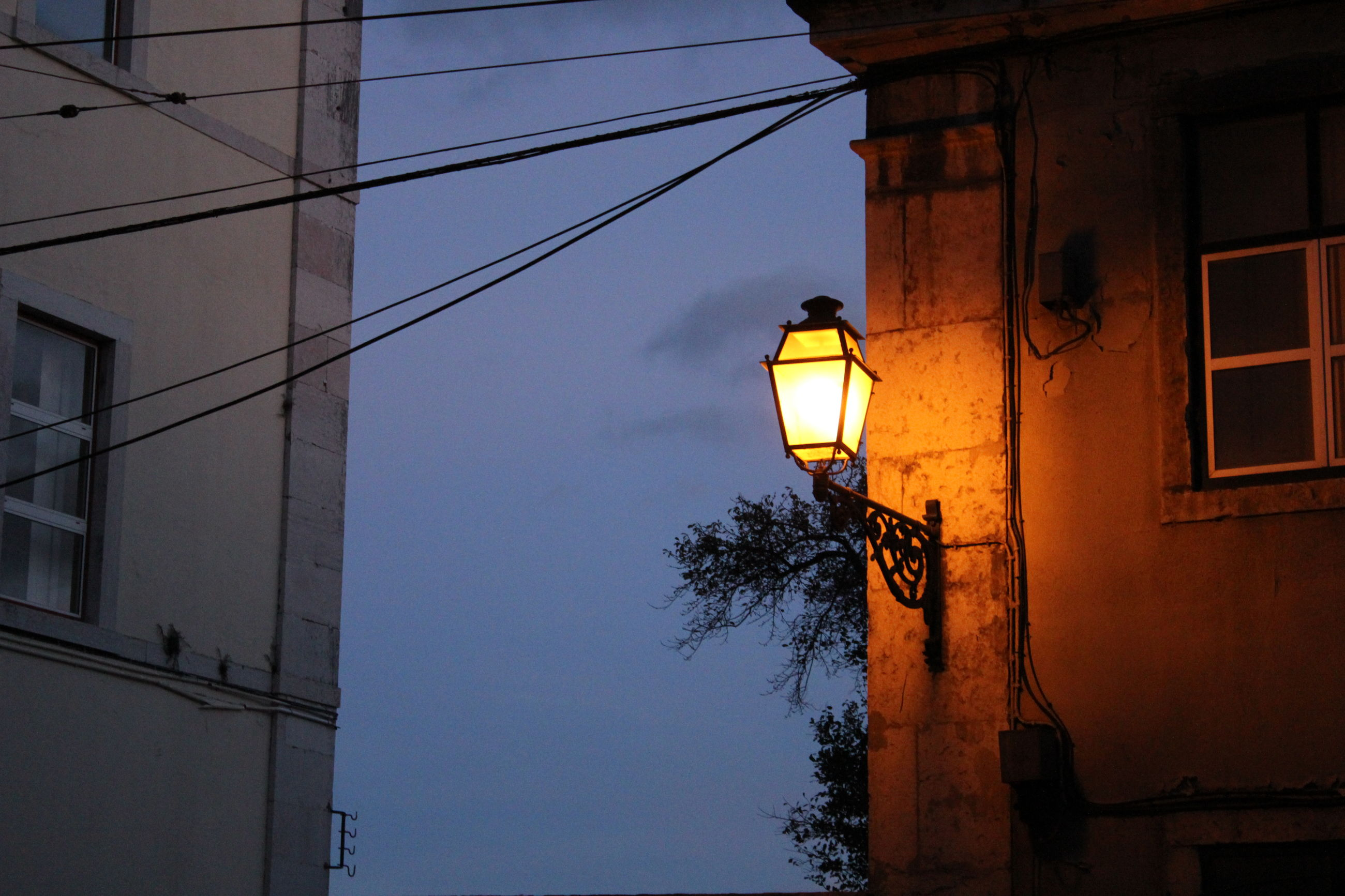 built structure, architecture, building exterior, residential structure, residential building, window, street light, lighting equipment, building, blue, clear sky, illuminated, day, power line, outdoors, no people, residential district