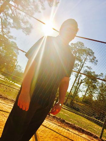 The sun it beautiful Sunlight Lens Flare Sunbeam One Person Real People Sun Day Lifestyles Boys Leisure Activity Sky Outdoors Low Angle View Standing Full Length Solar Flare Men Mammal Human Hand