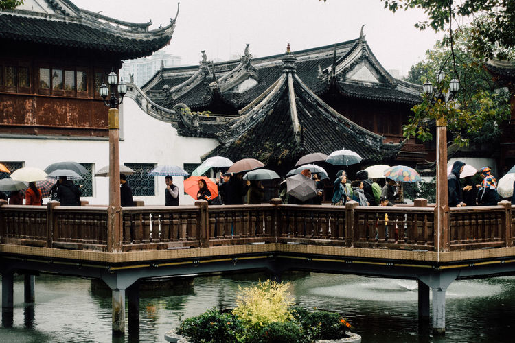 Yu Yuan Garden.... Water Nature Lake Outdoors Built Structure Architecture Building Exterior Building Day Group Of People Spirituality Waterfront Roof Bridge Umbrella Rain Rainy Days