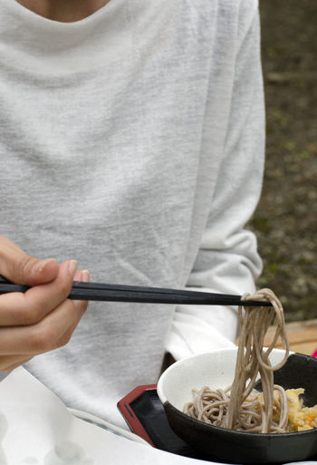 Chopsticks★★★ Hanging Out Lunch Meal Noodles Bowl Chopsticks Close-up Day Food Food And Drink Freshness Healthy Eating Holding Human Body Part Human Hand Midsection One Person Outdoors People Ready-to-eat Real People