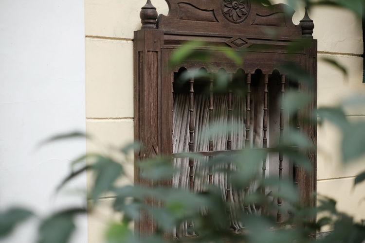 Close-up of old metal door of building