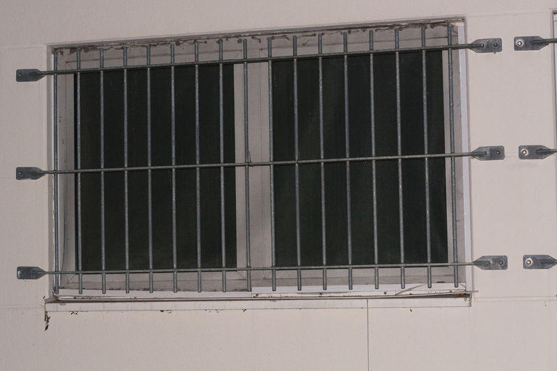 Installation of window grid of metal as protection against intruders. Security grille for windows, doors and balconies. Crime Lattice Architecture Building Exterior Built Structure By Way Of Punishment Close-up Day Grate House No People Outdoors Prison Security Bar Sky Trapped House Window Window Grilles