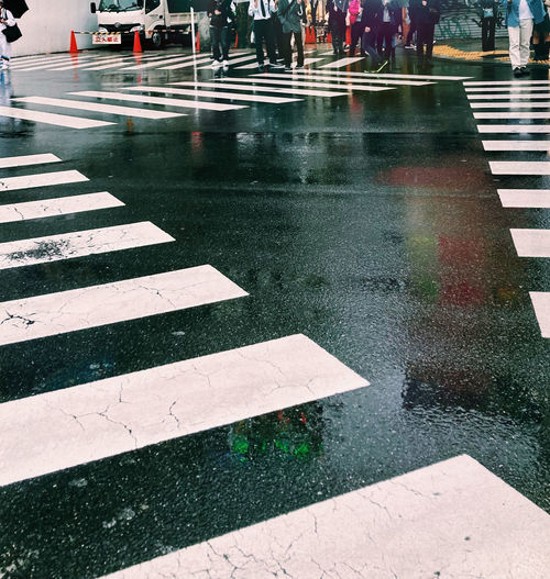 Wet road marking on city street during rainy season