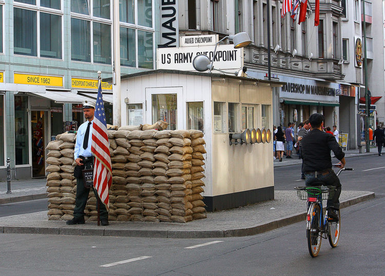 Checkpoint Charlie - Berlin, Germany Us Army A Taste Of Berlin Berlin Adult Architecture Bicycle Boy On Bicycle Boy On Bike Building Exterior Built Structure Checkpoint Charlie Berlin  City Day Flag Full Length Land Vehicle Large Group Of People Men Outdoors Patriotism People Real People Sandbags Walking Women Mobility In Mega Cities #FREIHEITBERLIN My Best Travel Photo A New Beginning