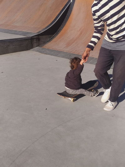 Dad and son Kid Baby Skateboarding Skate Skateboard Skateboarding Dad Son Low Section Men Sand Standing Togetherness Shadow Human Leg Focus On Shadow Legs Crossed At Ankle Canvas Shoe Flat Shoe Long Shadow - Shadow Shoe Human Feet Footwear Personal Perspective FootPrint Surfer Human Foot Friend Single Parent