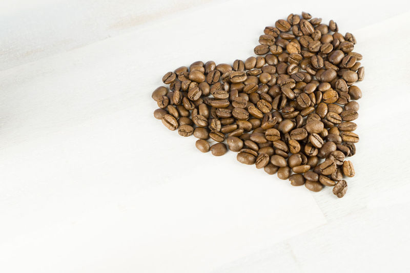 Coffee Copy Space Close-up Coffee Bean Coffee Beans Day Directly Above Food Food And Drink Freshness Healthy Eating Heart High Angle View Indoors  Large Group Of Objects No People Roasted Roasted Coffee Bean Still Life Studio Shot White Background