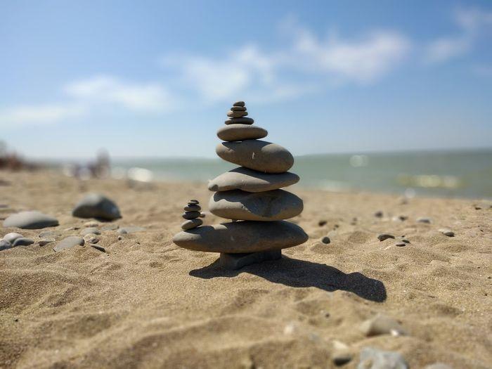 EyeEm Selects Sea Beach Sand Water Stack Salt - Mineral Balance Desert Summer Pebble Pyramid Shape Stack Rock