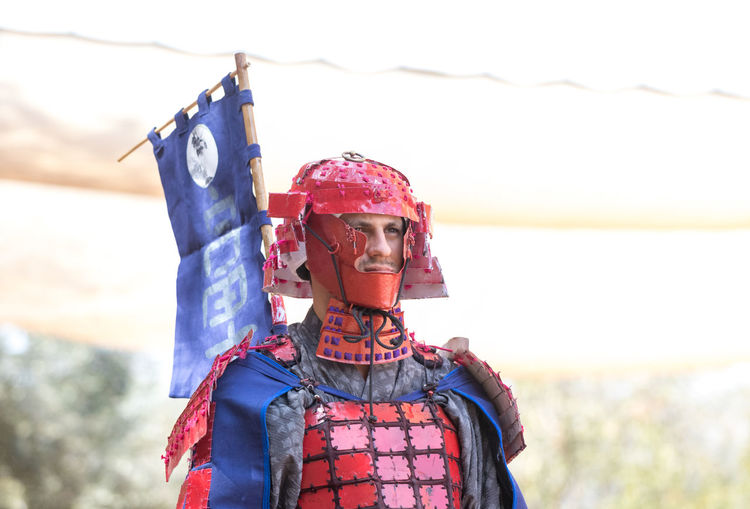 """Jerusalem, Israel, September 30, 2018 : Festival participant in a traditional samurai costume at the annual festival """"Jerusalem Knights"""" Business Fun International Japanese  Jerusalem Israel Jerusalem Knights Show Warrior Advertisement Art Battle Design Exhibition Festival Fighter Friendship Game Magician Medieval Samurai Spectator Symbol Traditional Costume Triumph Watching"""