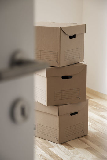 3 cardbox packaging box on wooden floor in empty room Packing Boxes Room Box Box - Container Business Cabinet Cardboard Container Door Drawer Emty Filing Cabinet Flooring Furniture Indoors  Move House No People Office Open Removal Still Life Wood - Material