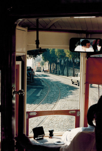Diminishing Perspective Footpath Journey Land Vehicle Lisbon Tram Mode Of Transport Person Public Transport Road The Way Forward Transportation Shot With Contax RTS Scan From Paper