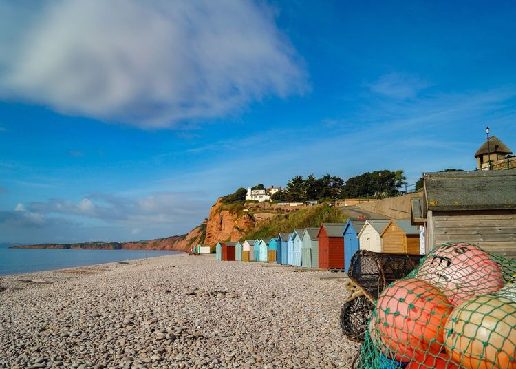 Sky Beach Water Sea Blue Tranquil Scene Built Structure Architecture Solitude Shore Tranquility Sand Cloud Scenics Ocean Calm Day Nature Cloud - Sky Outdoors Budleigh Salterton Devon No People Beach Huts Vibrant Color
