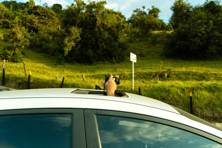Man photographing from car