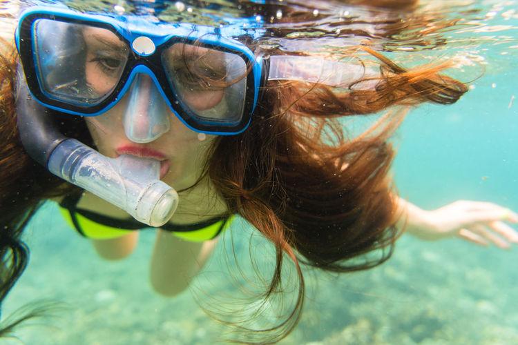 Close-up of woman snorkeling undersea