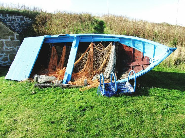 Boat Fishing Boat Nets Blue On Land Grass Findhorn Scotland Colour Of Life