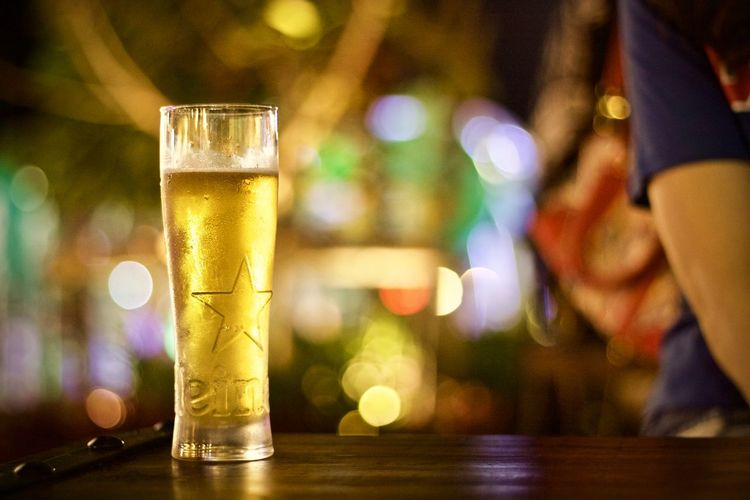 Drink Table Refreshment Glass Drinking Glass Food And Drink Household Equipment Alcohol Focus On Foreground Beer Indoors  Beer - Alcohol Incidental People Business Bar - Drink Establishment Close-up Restaurant Glass - Material Beer Glass Illuminated Bar Counter Pint Glass Happy Hour