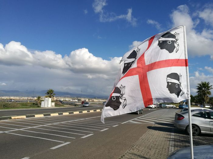 Cloud - Sky Outdoors No People Sardegna Sardinia Sardinia Sardegna Italy  4 Mori Quattro Mori Flag Flags In The Wind  Bandiera