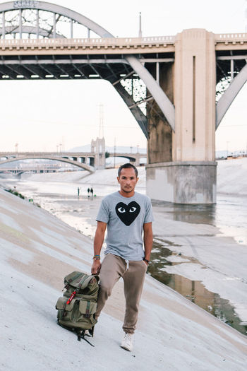Photographer's self portrait at Los Angeles river, Downtown L.A. California DTLA Los Angeles International Airport Los Angeles, California Adult Bridge - Man Made Structure Built Structure Casual Clothing Day Downtown Los Angeles Front View Full Length Lifestyles Looking At Camera One Person Outdoors Portrait Real People Self Portrait Standing Young Adult The Portraitist - 2018 EyeEm Awards