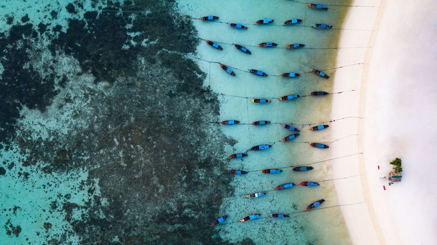 High angle view of nautical vessels moored on sea
