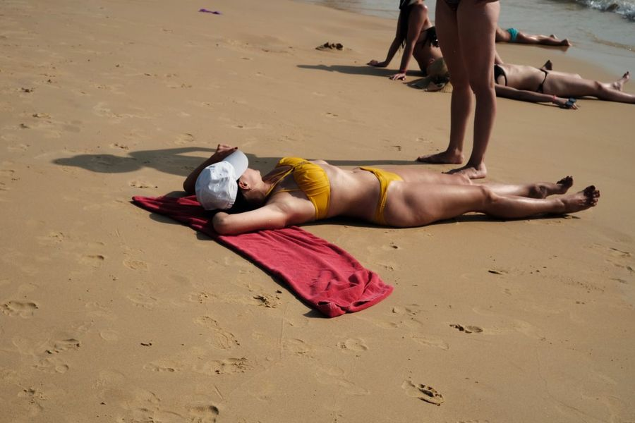 Vacations Sea Yellow Red Cloth Woman Girl Sand Lying Down Land People Beach Lifestyles Relaxation