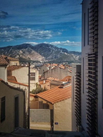 Mountain Sky Architecture Building Exterior No People Day Water City Outdoors Cityscape Prison Streetphotography Marseille Architecture Road Façade Montains And City Marseille City Perspectiva Perspectivematters