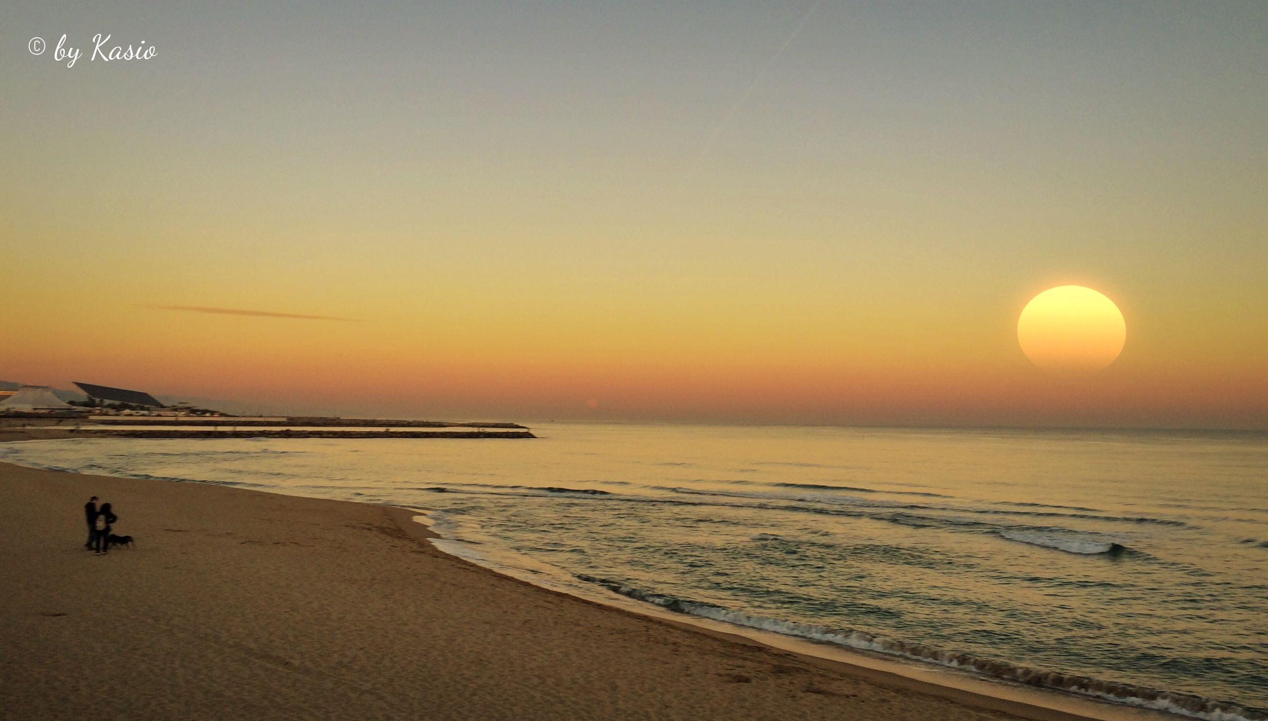 sea, horizon over water, beach, sunset, water, shore, scenics, tranquil scene, beauty in nature, tranquility, orange color, sand, idyllic, nature, sky, wave, sun, coastline, incidental people, outdoors