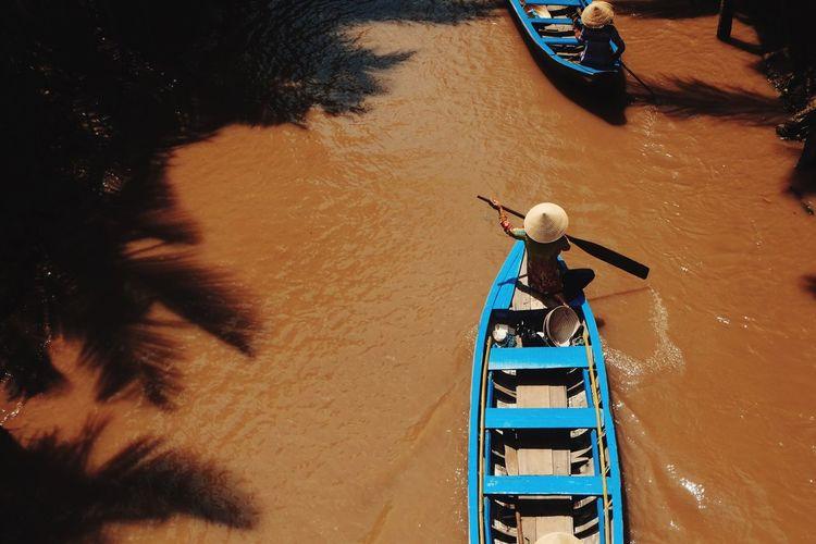 High Angle View Of People Boating On Mekong River