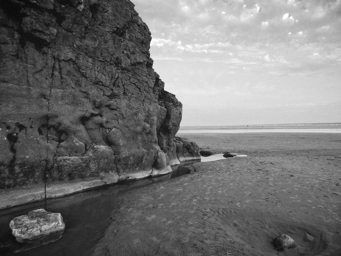 Wales Sea Horizon Over Water Water Shore Tranquil Scene Scenics Beach Sky Tranquility Rock - Object Beauty In Nature Nature Idyllic Remote Outdoors Non-urban Scene Solitude Day Cliff Rock Formation Black And White