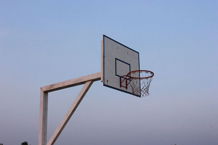 Basketball Basketball - Sport Basketball Hoop Blue Clear Sky Copy Space Court Day Leisure Games Low Angle View No People Outdoors Scoreboard Sport