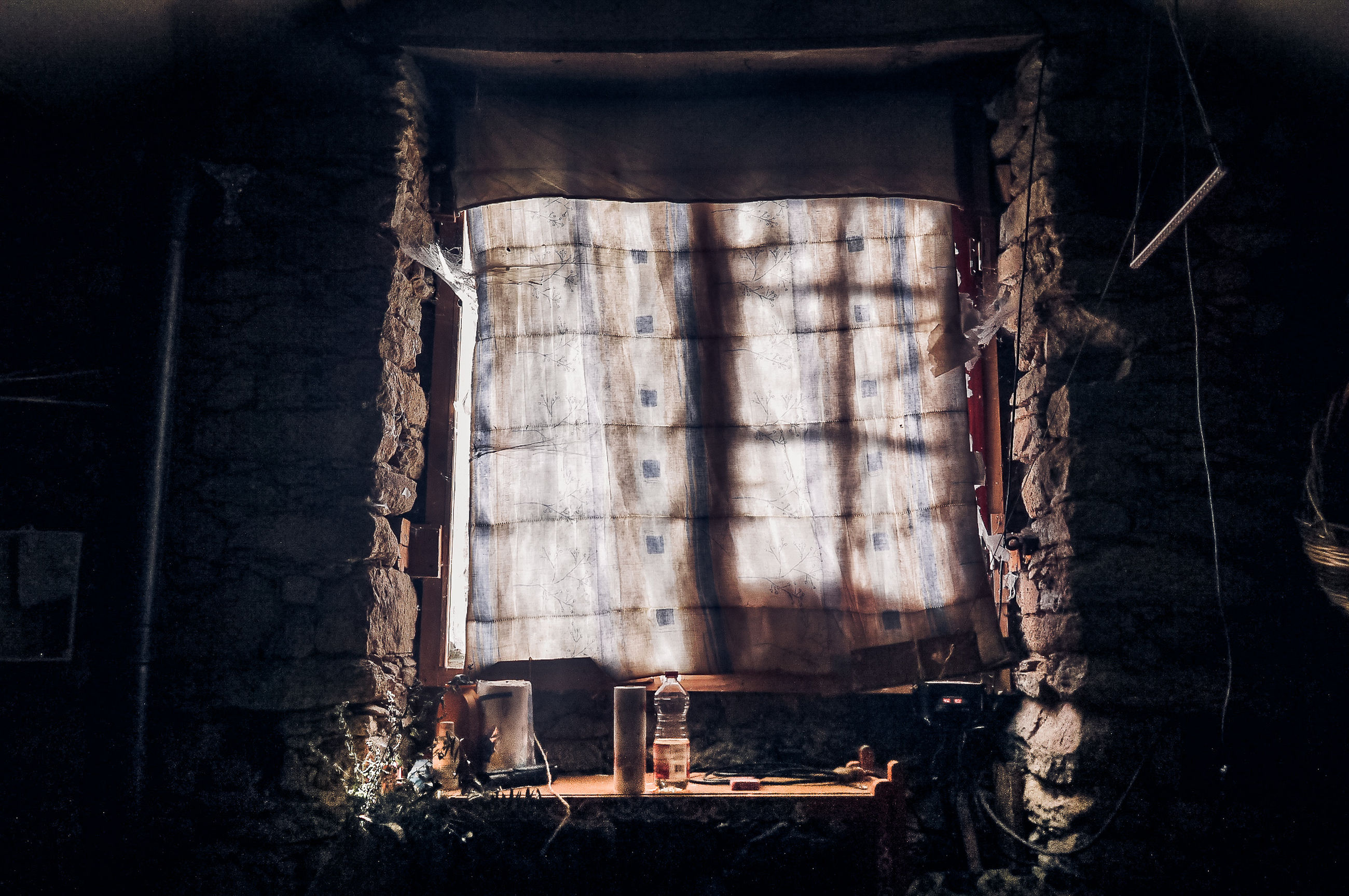 abandoned, architecture, window, indoors, day, old, built structure, no people, nature, damaged, building, hanging, sunlight, rope, wood - material, run-down, dark, curtain, shadow, ruined